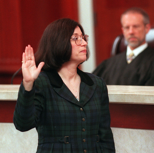 Denise Posse Lindberg is sworn in as a Utah judge .   Hartmann/photo