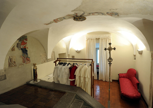 This picture made available Tuesday, March 12, 2013 by the Vatican newspaper L'Osservatore Romano shows the three sizes of the pope's garments in a room next to the Sistine Chapel, at the Vatican. Cardinals enter the Sistine Chapel on Tuesday to elect the next pope amid more upheaval and uncertainty than the Catholic Church has seen in decades: There's no front-runner, no indication how long voting will last and no sense that a single man has what it takes to fix the many problems. The three identical white outfits in small, medium and large for the new pontiff's first appearance on the balcony of St. Peter's Basilica are delivered to the Vatican before the start of the conclave and left in a room next to the Sistine Chapel, where the newly elected pope changes into his new clothes. (AP Photo/L'Osservatore Romano, ho)