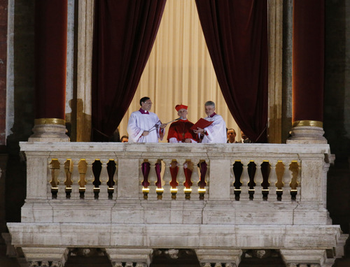 Cardinal Jean-Louis Tauran announces the newly elected Pope Jorge Mario Bergoglio, who took the name of Pope Francis, elected on Wednesday, March 13, 2013 the 266th pontiff of the Roman Catholic Church from the central balcony of St. Peter's Basilica at the Vatican. (AP Photo/Michael Sohn)