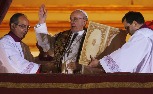 Pope Francis blesses the crowd from the central balcony of St. Peter's Basilica at the Vatican, Wednesday, March 13, 2013. Cardinal Jorge Bergoglio, who chose the name of Francis is the 266th pontiff of the Roman Catholic Church.  (AP Photo/Dmitry Lovetsky)