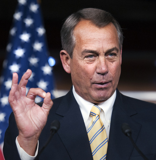"""House Speaker John Boehner of Ohio, makes a """"zero"""" gesture as he speaks with reporters about the federal budget on Capitol Hill in Washington, Thursday, March 14, 2013. Boehner was referring to President Barack Obama's federal budget which received zero votes in 2012 when it was rejected 414-0 in the House and 99-0 in the Senate. (AP Photo/Cliff Owen)"""