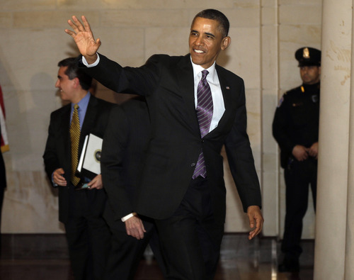 President Barack Obama waves to members of the media as he heads to a meeting with House Democratic Caucus on Capitol Hill in Washington, Thursday, March 14, 2013.(AP Photo/Pablo Martinez Monsivais)