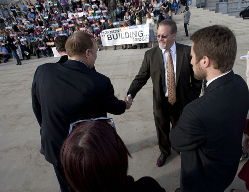 Steve Griffin | The Salt Lake Tribune   Sen. Steve Urquhart, R-St. George, right, sponsor of SB262, shakes hands with Rep. Jim Dabakis, D-Salt Lake after speaking during a rally, sponsored by Equality Utah, supporting the bill prohibiting discrimination on the basis of sexual orientation and gender identity. Equality Utah was joined by members of the LGBT community as well as Kol Ami, NAACP, La Raza and Mormons Building Bridges during the event at the capitol in Salt Lake City, Utah Wednesday March 13, 2013.
