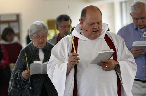 Scott Sommerdorf     The Salt Lake Tribune              Rector Mike Mayor of All Saints Episcopal Church leads a procession as part of their Palm Sunday services, Sunday, April 1, 2012.