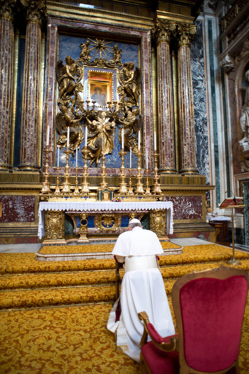 In this photo provided by the Vatican newspaper L'Osservatore Romano, Pope Francis kneels in prayer in front of the icon of the Virgin Mary inside St. Mary Major Basilica, in Rome, Thursday, March 14, 2013. Pope Francis opened his first morning as pontiff by praying Thursday at Rome's main basilica dedicated to the Virgin Mary, a day after cardinals elected him the first pope from the Americas in a bid to revive a Catholic Church in crisis and give it a preacher with a humble touch. (AP Photo/L'Osservatore Romano, ho)