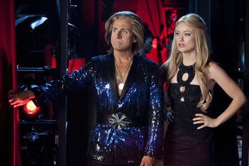 """This film image released by Warner Bros. Pictures shows Steve Carell, left, and Olivia Wilde in a scene from, """"The Incredible Burt Wonderstone."""" (AP Photo/Warner Bros. Pictures, Ben Glass)"""