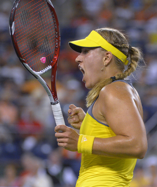 Angelique Kerber, of Germany, reacts after winning a point over Caroline Wozniacki, of Denmark, at the BNP Paribas Open tennis tournament, Friday, March 15, 2013, in Indian Wells, Calif. (AP Photo/Mark J. Terrill)