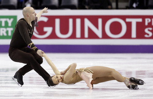 Mari Vartmann and Aaron Van Cleave, of Germany, perform during the pairs free program at the World Figure Skating Championships Friday, March 15, 2013, in London, Ontario. (AP Photo/Darron Cummings)