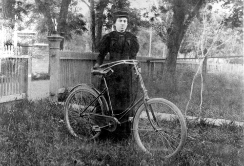 Photos courtesy of Utah Historical Society  A Utah woman with her bicycle around 1900.