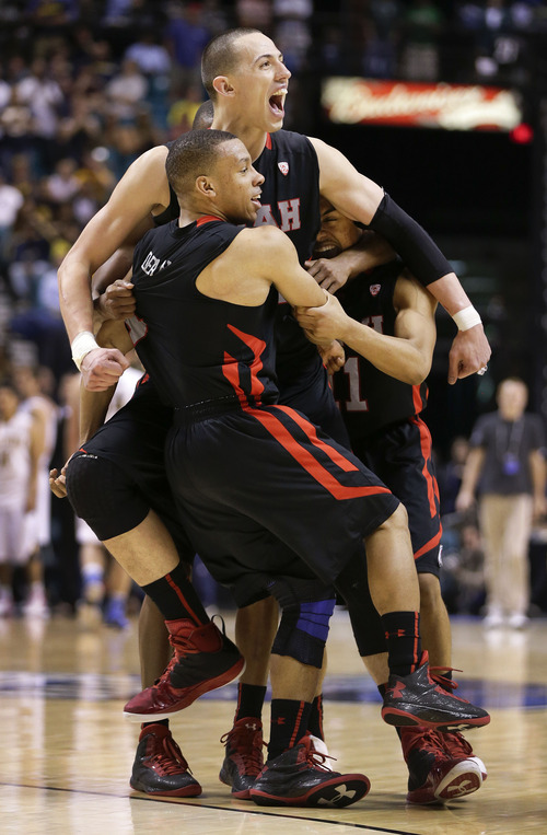 Utah's Jason Washburn, center, celebrates with Glen Dean, left, and Brandon Taylor after Utah defeated California 79-69 in overtime of a Pac-12 tournament NCAA college basketball game, Thursday, March 14, 2013, in Las Vegas. (AP Photo/Julie Jacobson)