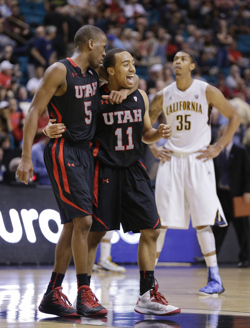 Utah's Jarred DuBois (5) and Brandon Taylor (11) react as California's Richard Solomon looks up after a California foul late in overtime during a Pac-12 men's tournament NCAA college basketball game, Thursday, March 14, 2013, in Las Vegas. Utah won 79-69. (AP Photo/Julie Jacobson)