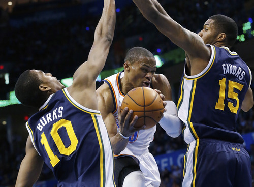 Unless the Jazz start doing a better job of slowing the likes Oklahoma City Thunder guard Russell Westbrook (0), their playoff chances appear to be getting more slim by the day. (AP Photo/Sue Ogrocki)