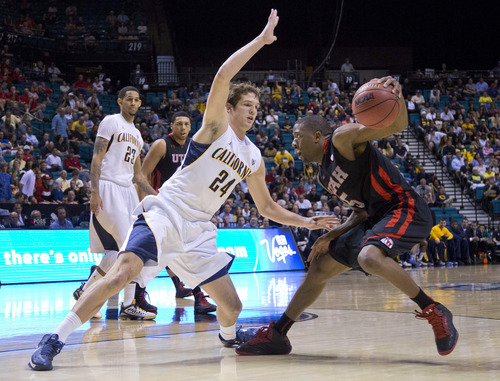 Utah's Jarred DuBois (5) looks to drive around California's Ricky Kreklow (24) during the second half of a Pac-12 men's tournament NCAA college basketball game, Thursday, March 14, 2013, in Las Vegas. Utah won in overtime, 79-69. (AP Photo/Julie Jacobson)