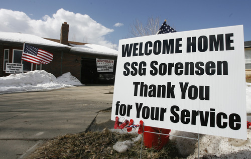 Rick Egan  | The Salt Lake Tribune   A sign welcomes Staff Sgt. Ben Sorensen home as he returns from his deployment in Afghanistan Wednesday, March 6, 2013.  Sorensen's wife Brittany surprised him by getting his Chevy Blazer fixed up with  donations from an auto parts company and repair shop in Layton.