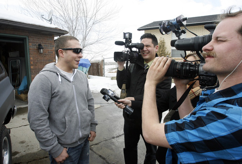Rick Egan  | The Salt Lake Tribune   Staff Sgt. Ben Sorensen talks to reporters after being surprised by his wife Brittany Wednesday, March 6, 2013 with Ben's Chevy Blazer she had fixed up while he was deployed to Afghanistan. Brittany fixed up the Blazer with donations from an auto parts company and repair shop.