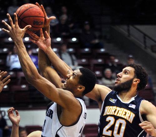 Northern Arizona's Gaellan Bewernick (20) and Weber State's Joel Bolomboy battle for a rebound during their NCAA college basketball game in the Big Sky Conference tournament, Thursday, March 14, 2013, in Missoula, Mont. Weber State won 84-58. (AP Photo/The Missoulian, Michael Gallacher)  MAGS OUT; TV OUT
