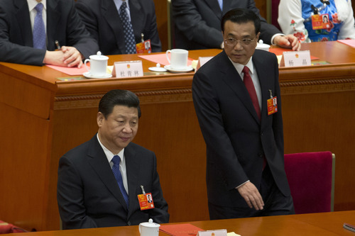 Incoming Premier Li Keqiang, right, walks past Chinese President Xi Jinping during a plenary session of the National People's Congress where Li is expected to be named China's new premier in Beijing Friday, March 15, 2013. (AP Photo/Ng Han Guan)
