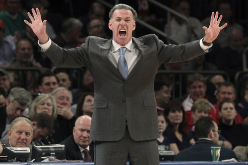Pittsburgh head coach Jamie Dixon yells at his team during the first half of an NCAA college basketball game against Syracuse at the Big East Conference tournament, Thursday, March 14, 2013, in New York. Syracuse won 62-59. (AP Photo/Mary Altaffer)