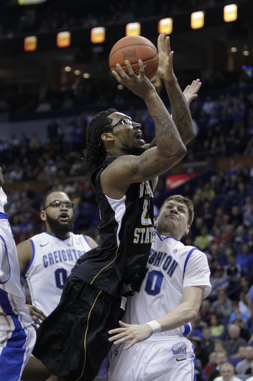 Wichita State's Carl Hall (22) collides with Creighton's Grant Gibbs (10) as he elevates for the shot in the first half of an NCAA college basketball game in the championship of the Missouri Valley Conference tournament  Sunday  March 10, 2013 in St. Louis.(AP Photo/Tom Gannam)