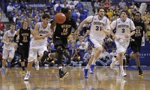Wichita State's Nick Wiggins (15) brings the ball upcourt against Creighton in the first half of an NCAA college basketball game in the championship of the Missouri Valley Conference tournament on Sunday, March 10, 2013, in St. Louis. (AP Photo/Tom Gannam)