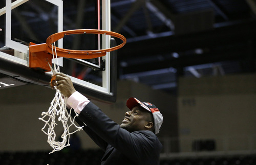Southern head coach Roman Banks cuts down the net following their NCAA college basketball game against Prairie View A&M in the championship of Southwestern Athletic Conference tournament Saturday, March 16, 2013, in Garland, Texas. Southern won 45-44. (AP Photo/Tony Gutierrez)