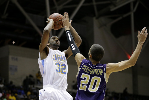 Southern's Brandon Moore (32) attempts s a shot over Prairie View A&M's Jules Montgomery (20) during an NCAA college basketball game in the championship of Southwestern Athletic Conference tournament Saturday, March 16, 2013, in Garland, Texas. (AP Photo/Tony Gutierrez)