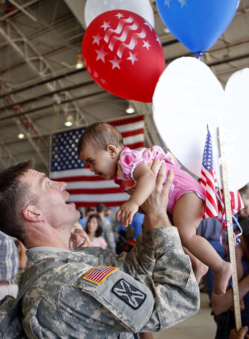 Trent Nelson  |  The Salt Lake Tribune  Sgt. Rocky Kerr holds his niece Maya Pérez as the Utah National Guard's 141st Military Intelligence Battalion returned to Salt Lake City, Utah, from duty in Iraq Wednesday, June 15, 2011. Some 275 soldiers of the 141st deployed in June last year.
