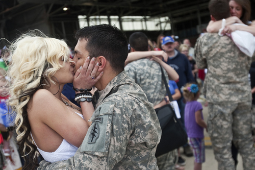 Chris Detrick | The Salt Lake Tribune   Jessica Tingey kisses her husband, Sgt. Kendall Tingey, as he arrives at the Utah Air National Guard Base Saturday May 14, 2011.  About 100 Soldiers of the Utah National Guard's Group Support Company, 19th Special Forces Group (Airborne), returned to Utah from their 12-month deployment to Iraq.