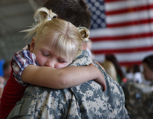 Trent Nelson  |  The Salt Lake Tribune  Macy Yoder, 4, embraces her uncle Sgt Shawn Yoder, as the Utah National Guard's 141st Military Intelligence Battalion returned to Salt Lake City, Utah, from duty in Iraq Wednesday, June 15, 2011. Some 275 soldiers of the 141st deployed in June last year.