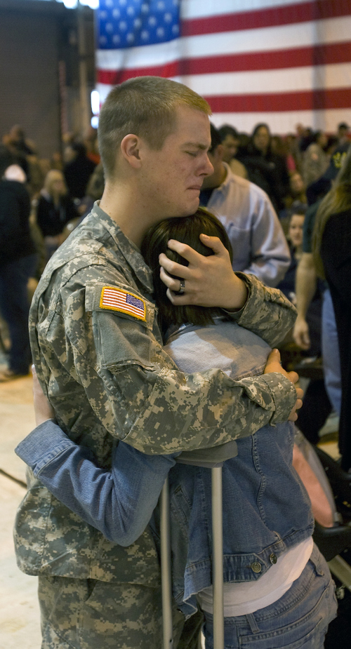 Al Hartmann | The Salt Lake Tribune  Josh Healey, with the 2-211th Aviation Battalion of the Utah National Guard keeps a stiff upper lip as he hugs his wife Jeanine goodbye at the Utah Air National Guard base hangar in Salt Lake City, February 20, 2008.