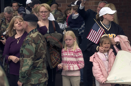 Friends and family members show their emotions as they say  goodbye to their loved ones in the 872nd Army Reserve maintainence Division bound for Iraq.    About 270 left from Ogden Tuesday.     Hartmann/photo   5/17/05