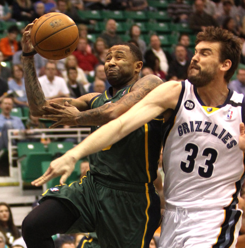 Rick Egan  | The Salt Lake Tribune   Utah Jazz point guard Mo Williams (5) gets past Memphis Grizzlies center Marc Gasol (33) in NBA action, The Utah Jazz vs. The Memphis Grizzlies at EnergySolutions Arena, Saturday, March 16, 2013.