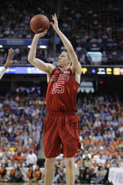 North Carolina State's Scott Wood (15) shoots against Miami during the second half of an NCAA college basketball game in the semifinals of the Atlantic Coast Conference tournament in Greensboro, N.C., Saturday, March 16, 2013. (AP Photo/Bob Leverone)