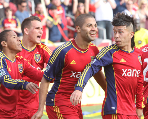 Rick Egan  | The Salt Lake Tribune   Real Salt Lake forward Jou Plata (8),  and midfielder Luis Gil (21) celebrate with forward Alvaro Saboru (15)  and Real Salt Lake midfielder Sebastian Velasquez (26), after Saboru scored the only goal of the day for Real Salt Lake, as they ended in a 1-1 tie with Colorado, in MLS soccer action, at RIo Tinto Stadium, Saturday, March 16, 2013.