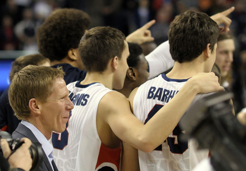 Gonzaga's coach Mark Few, left, celebrates with his team after their West Coast Conference Championship win in an NCAA college basketball game against Portland, Saturday, March 2, 2013, in Spokane, Wash. Gonzaga defeated Portland 81-52. (AP Photo/Jed Conklin)