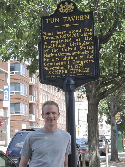 Utah native John Worsencroft, a Marine veteran of the Iraq war and a historian, stands next to a marker for Tun Tavern, the Philadelphia birthplace of the U.S. Marine Corps in 1775. Worsencroft is studying at Temple University in Philadelphia.  Courtesy John Worsencroft
