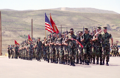 Capt. Mike Schoenfeld, saluting at right, with Fox Company, 2nd Battalion, 23rd Marines at Camp Pendleton, Calif. Schoenfeld was later promoted to major and commander of Fox Company.
