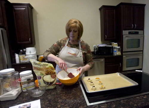 Kim Raff  |  The Salt Lake Tribune Lisa Barker, the outreach and education coordinator for Honeyville Grains, makes chocolate chip cookies using almond flour at the company's Salt Lake City store.