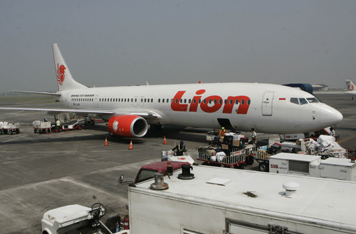 FILE- A Lion Air passenger jet plane is parked on the tarmac at Juanda International Airport in Surabaya, Indonesia, in this file photo dated May 12, 2012.    Indonesian airline Lion Air is to buy 234 short to medium range aircraft from Airbus it is announced Monday March 18, 2013, for euro 18.4 billion (US dlrs24 billion), in what is being billed as the biggest civilian deal in the history of the aircraft manufacturer. The contract was announced Monday at the French presidential palace, a sign of the deal's importance to the French government, and helping to secure around 5,000 jobs at a time when French unemployment hovers over 10 percent. (AP Photo/Trisnadi, File)