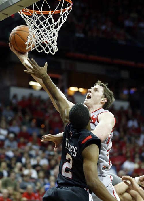 New Mexico's Cameron Bairstow shoots over San Diego State's Xavier Thames during the first half of a Mountain West Conference tournament NCAA college basketball game on Friday, March 15, 2013, in Las Vegas. (AP Photo/Isaac Brekken)