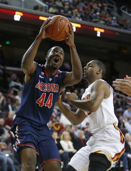 FILE - In this Feb. 27, 2013, file photo, Arizona's Solomon Hill, left, drives to the basket past Southern California's Byron Wesley during the first half of an NCAA college basketball game in Los Angeles.  Hill came to Arizona as a chubby freshman with a questionable outside shot and not-so-great defense. After four years of working on his game and his body, he'll leave as one of the program's most versatile players, a leader.  (AP Photo/Jae C. Hong, File)