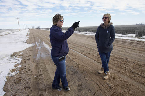 In this photo taken on March 11, 2013, sisters Jenni Harrington, left, and Abbi Kleinschmidt stand next to the proposed route of the Keystone XL pipeline on the property of Jenni Harrington near Bradshaw, Neb. An unusual coalition of environmentalists, property rights advocates and ranchers is attempting to find new ways to derail the Keystone XL pipeline project that, more than ever, seems to be headed for approval in a nation eager for jobs and energy development. (AP Photo/Nati Harnik)