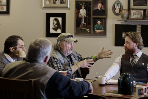 In this photo taken on March 12, 2013, pipeline opponent Tom Genung of Hastings, Neb., center, addresses Zack Hamilton, organic rancher and public advocacy coordinator Nebraska Farmers Union, right, Ken Winston, a Sierra Club lawyer, left, and rancher Randy Thompson, second left, at a meeting at Thompson's home in Martell, Neb. An unusual coalition of environmentalists, property rights advocates and ranchers is attempting to find new ways to derail the Keystone XL pipeline project that, more than ever, seems to be headed for approval. (AP Photo/Nati Harnik)