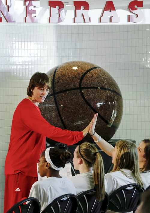 Nebraska head coach Connie Yori high-fives players after learning their NCAA college basketball tournament assignment, Monday, March 18, 2013, in Lincoln, Neb. Nebraska is scheduled to face Chattanooga in a first-round game Saturday in College Station, Texas. (AP Photo/Nati Harnik)