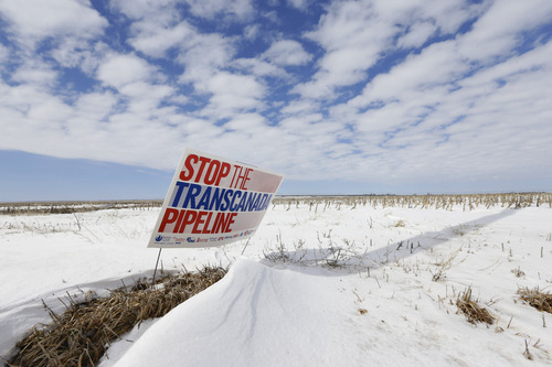 "In this photo taken on March 11, 2013, a sign reading ""Stop the Transcanada Pipeline"" stands in a field near Bradshaw, Neb. The proposed Keystone XL pipeline will run through this field, owned by Jenni Harrington. An unusual coalition of environmentalists, property rights advocates and ranchers is attempting to find new ways to derail the Keystone XL pipeline project that, more than ever, seems to be headed for approval. (AP Photo/Nati Harnik)"
