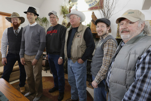 In this photo taken on March 12, 2013, pipeline opponents, from left:  Zack Hamilton, an organic rancher and public advocacy coordinator for the Nebraska Farmers Union, from Ceresco, Neb., Ken Winston, a Sierra Club lawyer, from Lincoln, Neb., Joe Moler, a landowner from York, Neb., Randy Thompson, a landowner, from Martell, Neb., Ben Gotschall, organic dairy farmer and activist with pipeline opposition group Bold Nebraska, from Hastings, Neb., Tom Genung, pipeline opponent from Hastings, Neb., all pose for a photo with their hats on. An unusual coalition of environmentalists, property rights advocates and ranchers is attempting to find new ways to derail the Keystone XL pipeline project that, more than ever, seems to be headed for approval in a nation eager for jobs and energy development. (AP Photo/Nati Harnik)