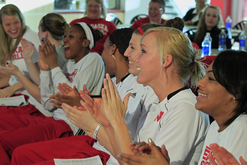 Nebraska players from right: Meghin Williams, Emily Cady, Jordan Hooper and Tear'a Laudermill, third left, react in Lincoln, Neb., Monday, March 18, 2013, after learning they will play Chattanooga in the first round of the NCAA women's basketball tournament on Saturday in College Station, Texas. (AP Photo/Nati Harnik)