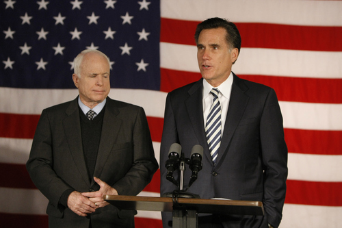 Former Republican presidential hopeful Mitt Romney, right, announces his support for Republican presidential hopeful, Sen. John McCain, R-Ariz., Thursday, Feb. 14, 2008, during a news conference in Boston. (AP Photo/Gerald Herbert)