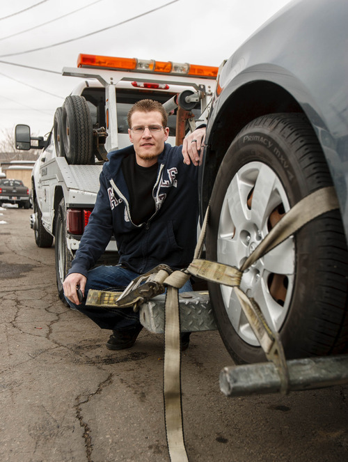 Trent Nelson     The Salt Lake Tribune Repo man Nolan Edwards with a car he has recently repossessed Friday, March 1, 2013 in Salt Lake City.