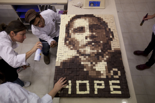 CAPTION CORRECTION, CORRECTS NAME OF SCHOOL - Students of the Holon Institute of Technology for bakery and pastry making, work on an image depicting U.S. President Barack Obama made out of chocolate in Givat Shmuel, central Israel, Monday, March 18, 2013. Obama's trip to Jerusalem and the West Bank will take place March 20-22, and it is the U.S. leader's first trip to the region as president, and his first overseas trip since being reelected. (AP Photo/Ariel Schalit)